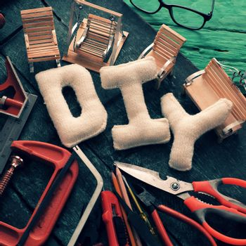Diy tools background with group of crafting tools like scissors, hammer, knife, equipment for handmade product on wood background, a hobby of dad to repair in home
