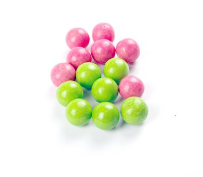 pink and green gumballs on a white background.