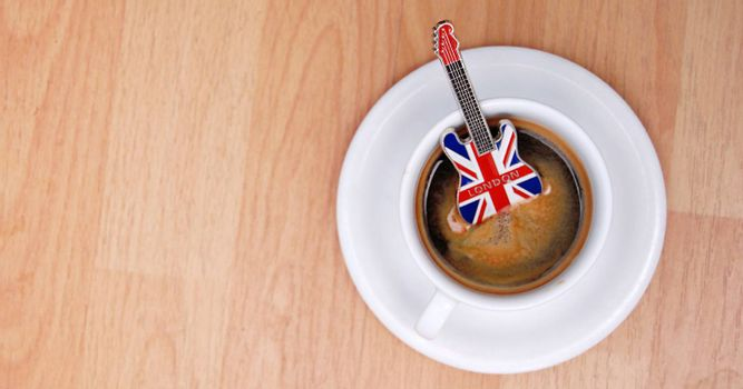 image of guitar souvenir from london in espresso cup