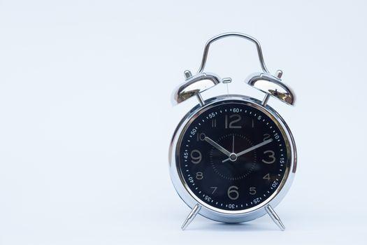 Alarm clock isolated on white background, stock photo