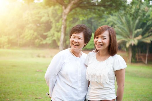 Asian elderly mother and grown daughter