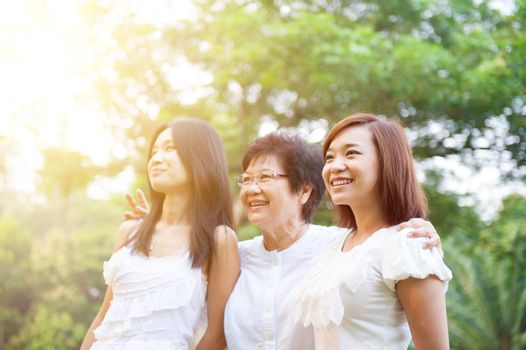Asian mother and grown daughters