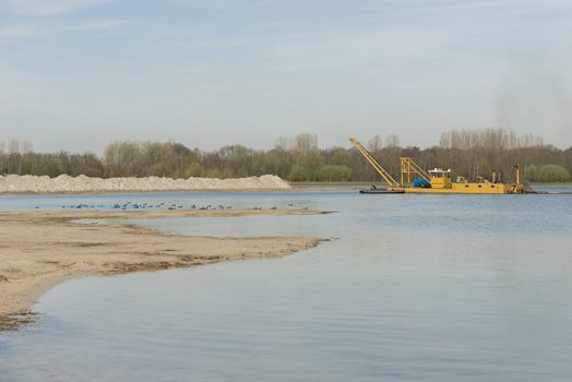Sand extraction on a recreational Lake
