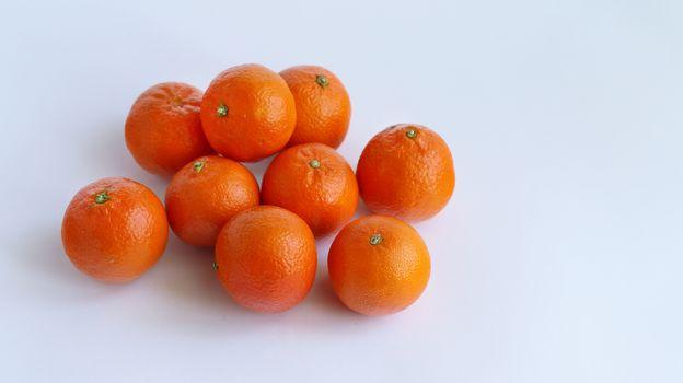 Pile of mandarin on white background. Food fruit