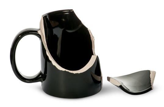 Broken black porcelain cup with one fragment