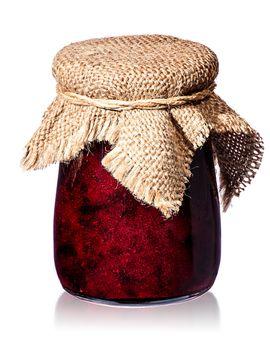 Currant jam in jar with burlap