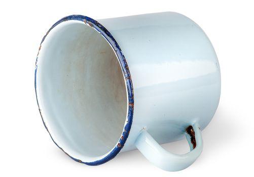Old worn enameled mug lying