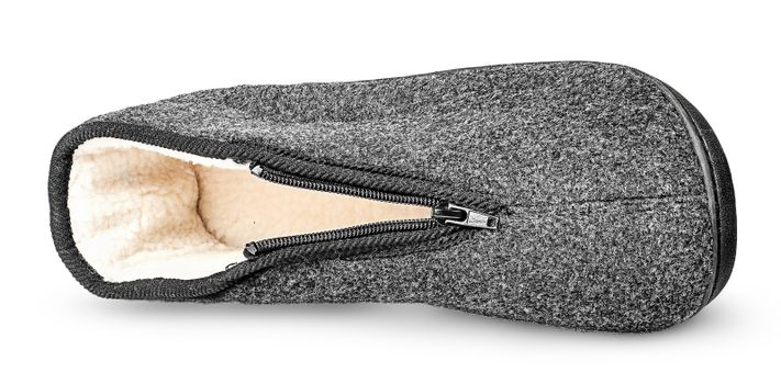 One piece the comfortable dark gray slipper lying on the side