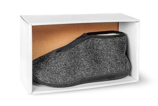 Single slipper in white cardboard box