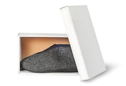 Single slipper in white cardboard box with lid