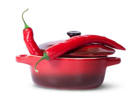 Two red chili peppers in saucepan with lid