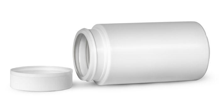 White plastic bottle for vitamins lying near lid