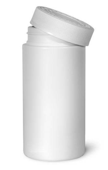White plastic bottle for vitamins with lid removed