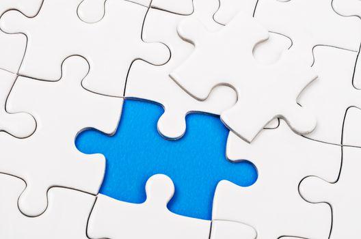 Plain white jigsaw puzzle.