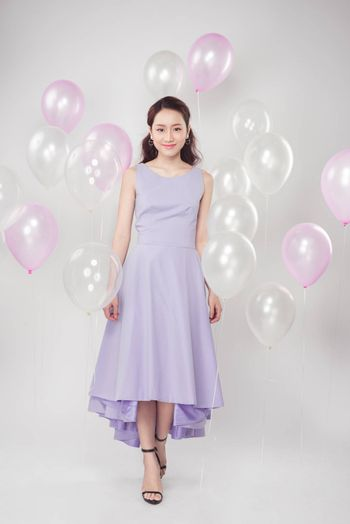 Full-length of fashion photo of beautiful woman with pastel ball