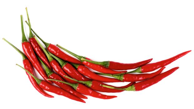 Arrangement of Perfect Red Hot Chili Peppers as Pepper Shape isolated on White background