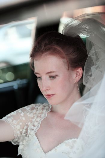 Beautiful the bride in car
