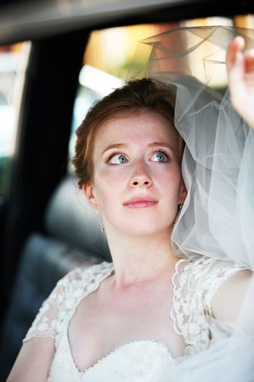 Beautiful the bride in car
