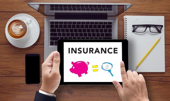 INSURANCE CONCEPT  , on the tablet pc screen held by businessman hands - online, top view