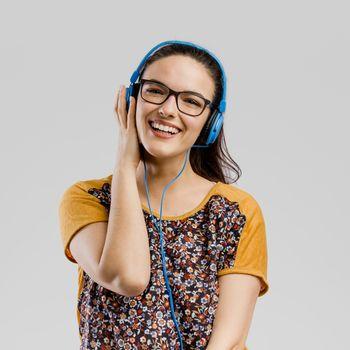 Portrait of Beautilful woman listen music