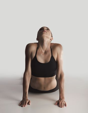 Shot of a young woman doing stretching exercises