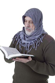 Muslim man with the Koran in their hands