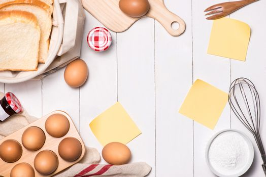 Eggs, milk and bread on white wooden background. Copy-space