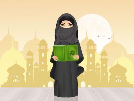 Muslim girl with Islam's holy book the Koran