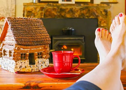 Feet Resting by the Fire With a Cup of Tea