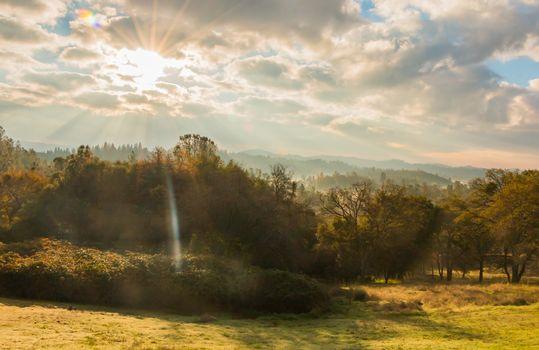 Sunlight Shinning Through the Clouds