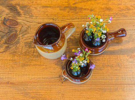 Crockery With Small Flowers on Wooden Table