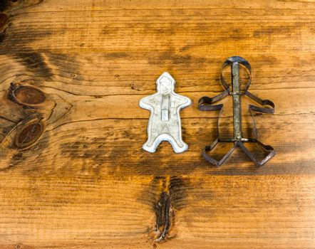 Tin Cookie Cutters Sitting on Wooden Table