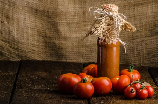 Homemade ketchup from tomatoes grown in organic garden