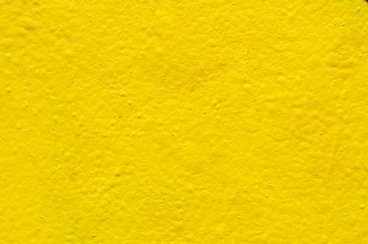 Yellow background image on the cement wall
