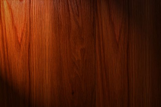Dark brown wood background with light on the left