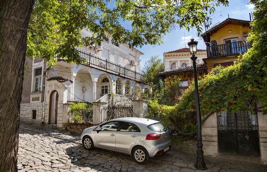 Beautiful view of several old houses in old town of Plovdiv, Bulgaria with a modern car in front.