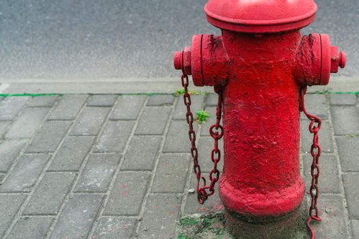 Red fire water hydrant beside the road