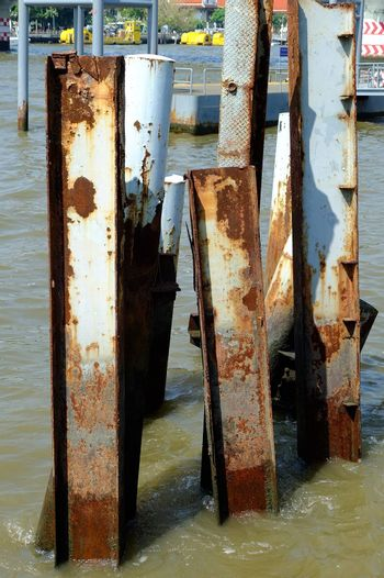 Metal posts left over from an old pier in Chao Phraya River Bangkok, Thailand.