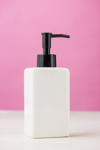 Spa composition with shampoo bottle on white.