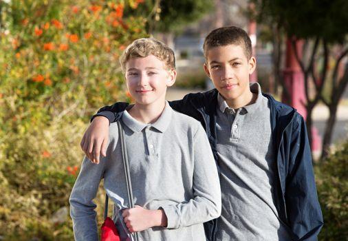 Friend with arm around schoolmate