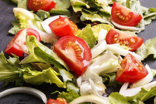 fresh summer salat with oil on slate