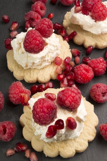 scottish oatmeal biscuits with whipped cream, fresh raspberries