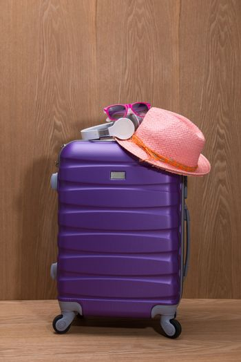 It's summer time. Travel bag and straw hat.