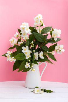 Fresh jasmine flowers in a vase