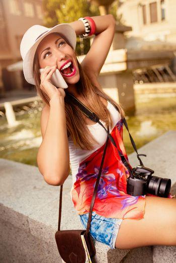 Young Woman Talking On A Smartphone