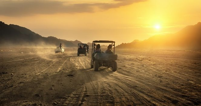 Buggy riding in desert