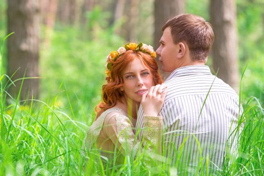 Beautiful lovers in forest