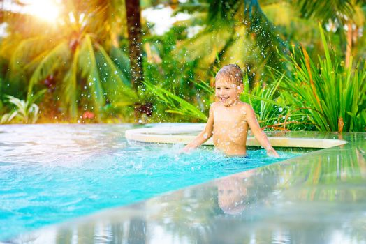 Cheerful boy in the pool