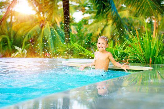 Cute boy in the pool