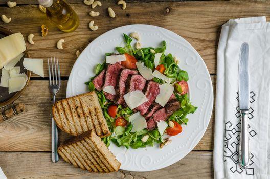 Rump steak with spicy herb butter